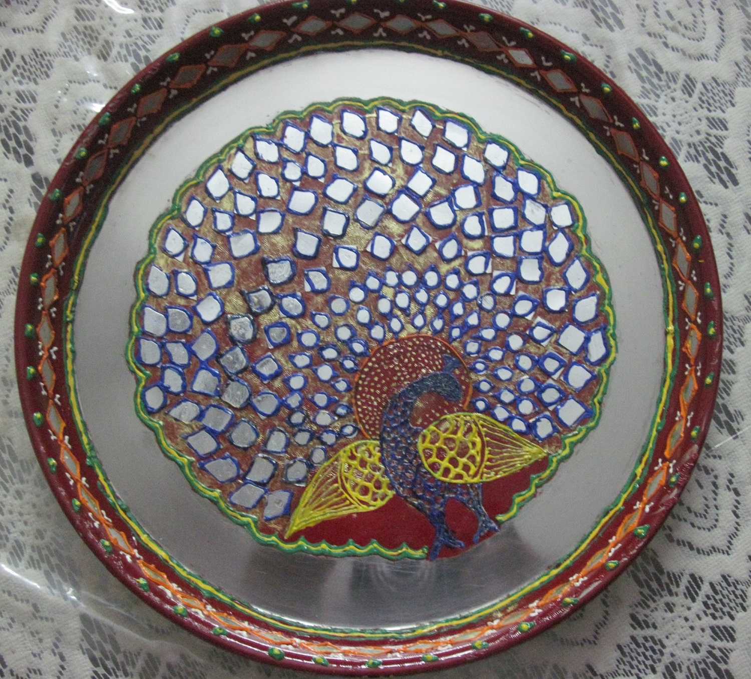 Decorative pooja thali peacock design madeup of clay and for Aarti thali decoration with clay