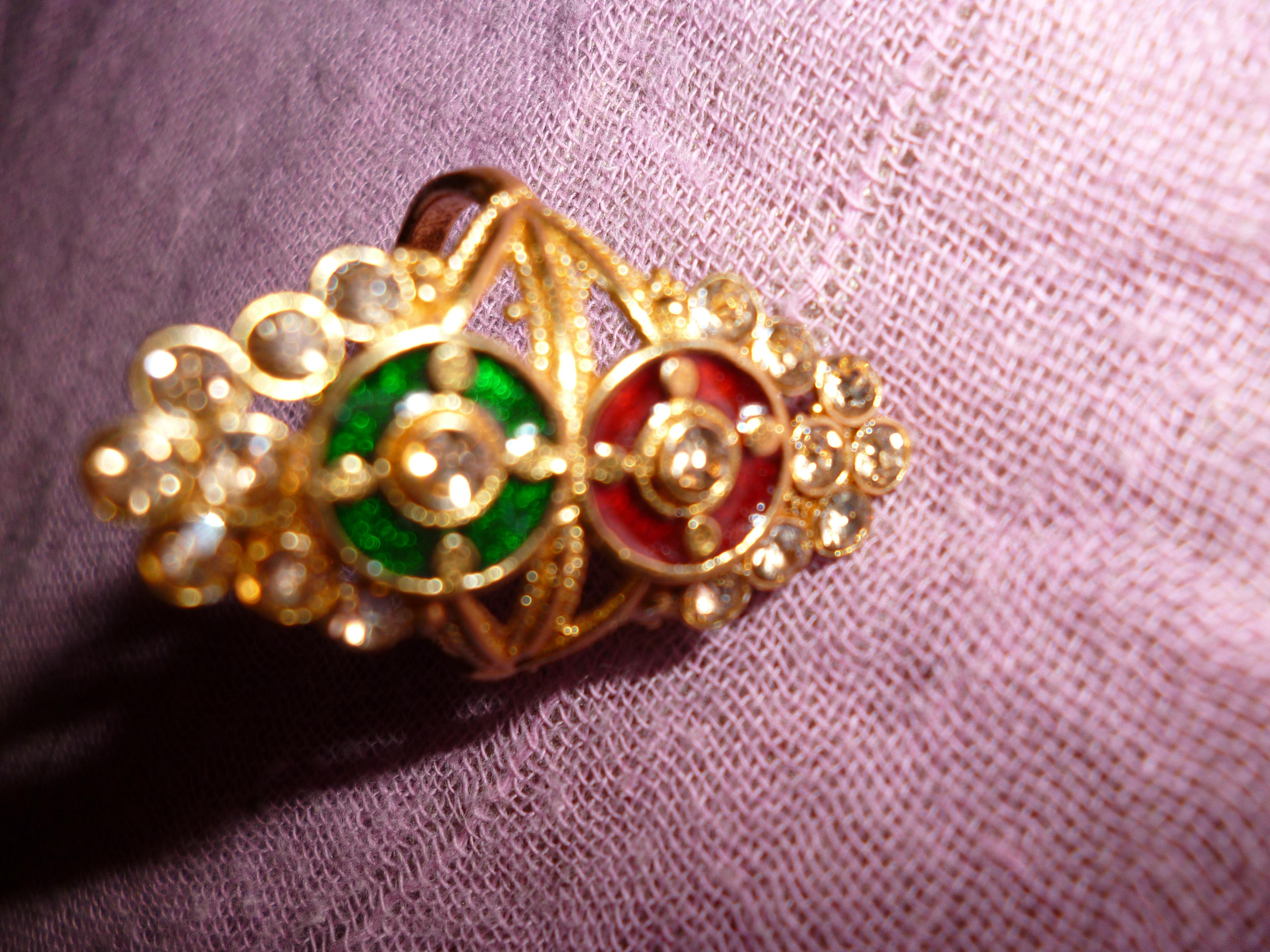A Gold Plated Very Cute Ring For Her In Red And Greeen Stone A Gold Plated Very Cute Ring For Her In Red And Greeen Stone