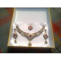 Combination Of Stones And  Kundan Work With A Beautiful Belnd Of Pink And Green Jewellery Set