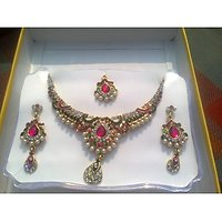 Combination Of Stones And  Kundan Work With A Beautiful Belnd Of Green And  Golden Jewellery Set