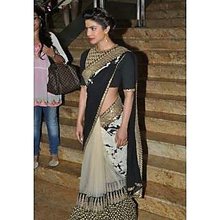 Priyanka Chopra Sizzles In A Black & Gold Saree