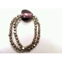 Silver Beads With Pink Heart Bracelet. GLITZY BY ROOHIE