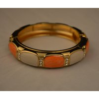 Magnifies 'kada' In Orange And White Colored Stone